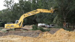 Excavator Taking Down Tree Stock Footage