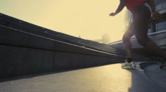 Runner on steps City hall London, UK, Slow motion, PAN up, wide shot Stock Footage