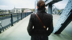 Young woman walking in an urban environment, steadicam shot Stock Footage