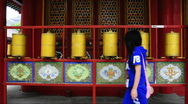 Bronze prayer wheel spinning in the Lama Temple, Stock Footage