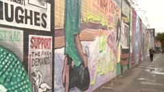 Walking past Belfast mural Stock Footage