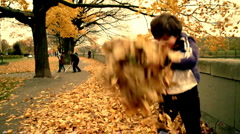 Stock Video Footage of Boy playing with leaves, steadicam shot, slow motion, shot at 60fps