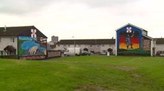 Belfast murals in housing estate Stock Footage