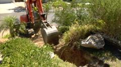 Excavator digs hole Stock Footage