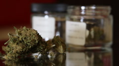 Medical Marijuana and Jars Rack focus Stock Footage