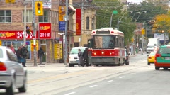 People traffic and streetcars in Toronto, tight shot Stock Footage
