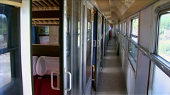 Inside a passenger train in the move. The interior of the train in motion Stock Footage
