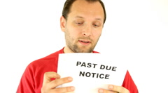 A worried man holding past due notice  - stock footage