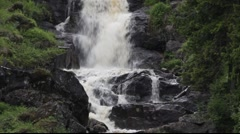 Waterfall in a forest in Sweden Stock Footage