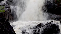 Waterfall gushing over rocks. Stock Footage