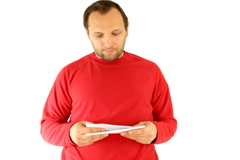 Stock Video Footage of Man reading past due notice, isolated on white