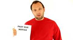Man holding past due notice, isolated on white - stock footage
