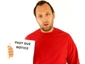 Stock Video Footage of Man holding past due notice, isolated on white