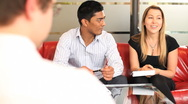 Stock Video Footage of Business group in conversation in meeting room and  taking notes