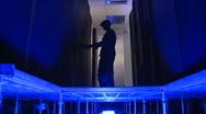 Data centre operator opens rack door Stock Footage