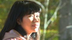 Filipino woman enjoying the autumn sun Stock Footage