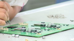 Hand-assembly in electronics plant Stock Footage