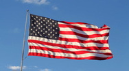 American Flag with Blue Sky Stock Footage