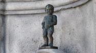 Figure of boy urinating Manneken Pis Stock Footage