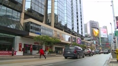 Low angle wide, traffic and street car, Toronto Stock Footage