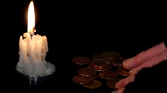 Poor Man Counting Money by candlelight Stock Footage