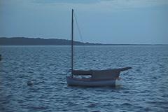 Moored sailboat at dusk Stock Footage