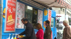 Food, truck mounted hot dog stand on city street Stock Footage