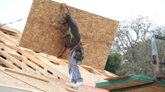 Roofer installing new roof - stock footage