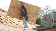 Stock Video Footage of Roofer installing new roof