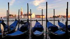 Gondolas moored in the Lagoon, with a view to San Giorgio Maggiorl Island Venice Stock Footage