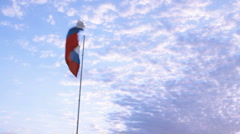 Russian flag on blue sky Stock Footage