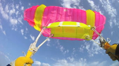 Parachutist falling down and open the parachute and flying - stock footage