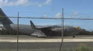 USAF C17 Global Master and Airliner Passing Behind in Airstrip Stock Footage