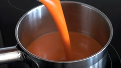 Pouring Soup into Pan Stock Footage