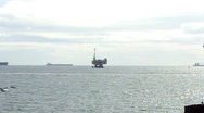 Distant Ocean Oil Drilling Platform and Transport Ships Stock Footage