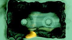 Burn cassette fire music audio tape Stock Footage