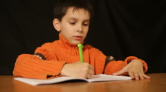 boy writes the handle - stock footage