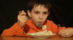 Boy eats pelmeni Stock Footage