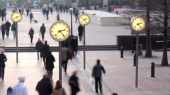London docklands people financial clock rush hour business commuters Stock Footage