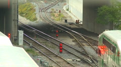 railroad, commuter trains leaving station - stock footage