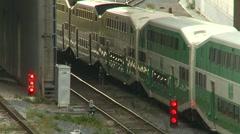 Railroad, commuter train leaving station, long double-decker Stock Footage