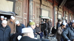 Muslims leave after church in china Stock Footage