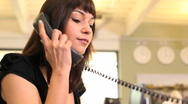 Stock Video Footage of Business female answering phone call in office