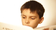 Boy reads books Stock Footage