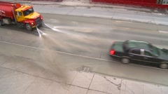 Truck streetwasher through frame, from 30' above Stock Footage