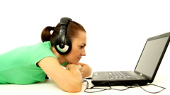 Woman with headphones and laptop, isolated  Stock Footage