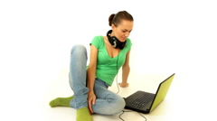 Happy attractive woman with headphones and laptop, isolated Stock Footage
