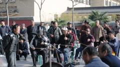 Older people singing opera in china - stock footage