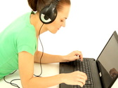 Woman with headphones working on laptop, isolated Stock Footage