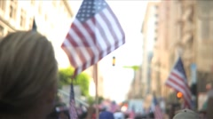 Stock Video Footage of Immigration march and rally - Follow flags